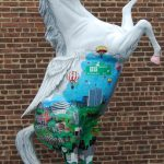 A horse statue painted by 3d pop artist Charles Fazzino for Horsin' Around Stamford