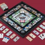 Full Game of the Fazzino version of Monopoly, laid out on a red carpet, with all the pieces placed for viewing