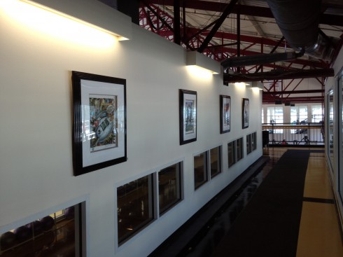 View looking down a Chelsea Pieres hallway where four of Fazzino sports artwork is hanging