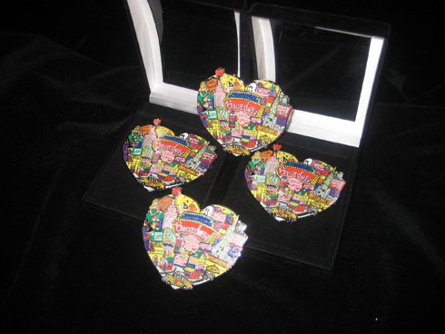 Image of 4 of Fazzino's broadway themed pins int he shape of a heart