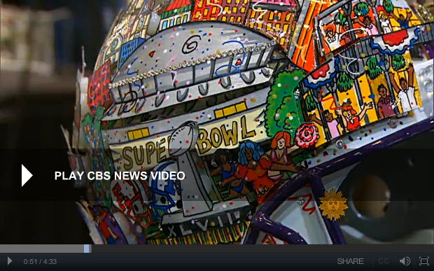 A close-up of a Fazzino helmet on the CBS Sunday Morning show