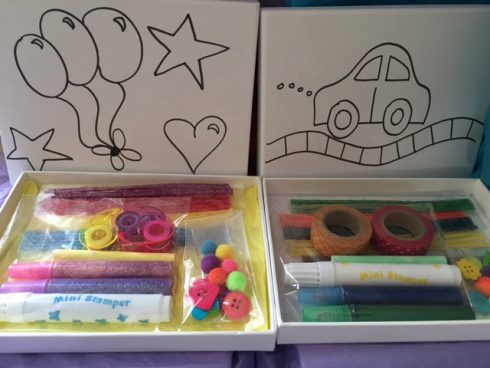 Craft on Wheels art kit for children with special needs including line drawings of balloons, stars and a car and colorful markers