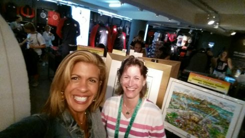 NBC News Anchor and TV personnel, Hoda Kotb, and Julie Maner in front of Charles Fazzino's 2016 Olympic Game pop art collection at the 2016 Summer Olympic Games in Rio.
