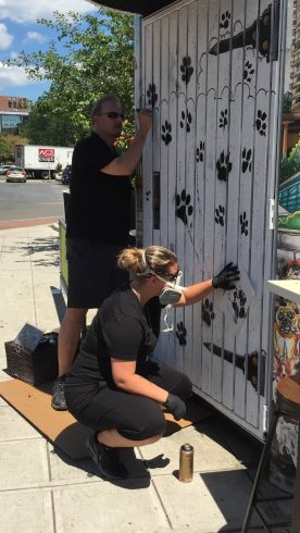 Charles and Heather Fazzino working on their latest pop-art piece, Downtown Dogs in Stamford