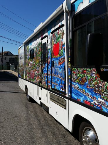 Side view of the custom wrapped Westchester Medical Center Health Center bus