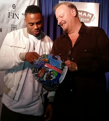 Fazzino presents Rashad Jennings with a custom made helmet