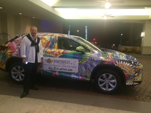 Fazzino standing in front of the 3d pop art wrapped Lexus for the 2016 Ft. Lauderdale Winterfest Boat Parade