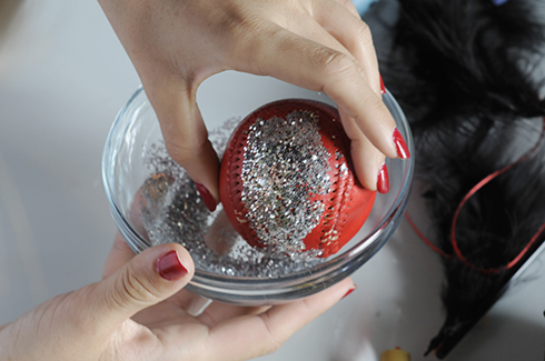 A bowl of glitter to dunk a baseball with glue to coat it