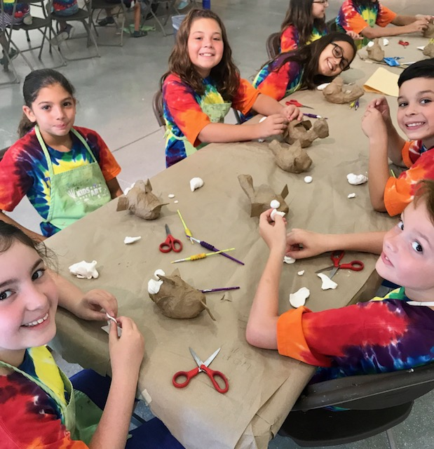Kids Need More Art at Pine Jog Environmental Science create Pufferfish out of recycled baseballs by using paper mache and model magic