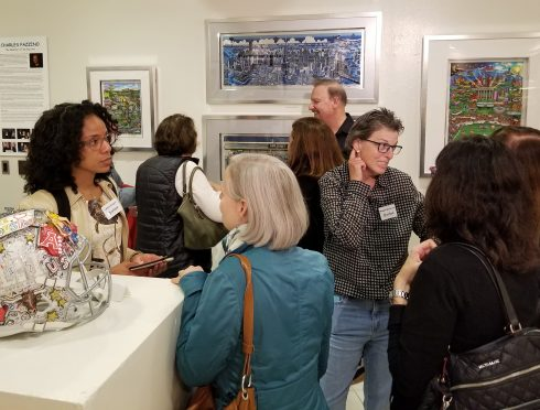 "People conversating at the opening reception of ""The 3D World of Fazzino"" at the MAC Gallery in New Rochelle"