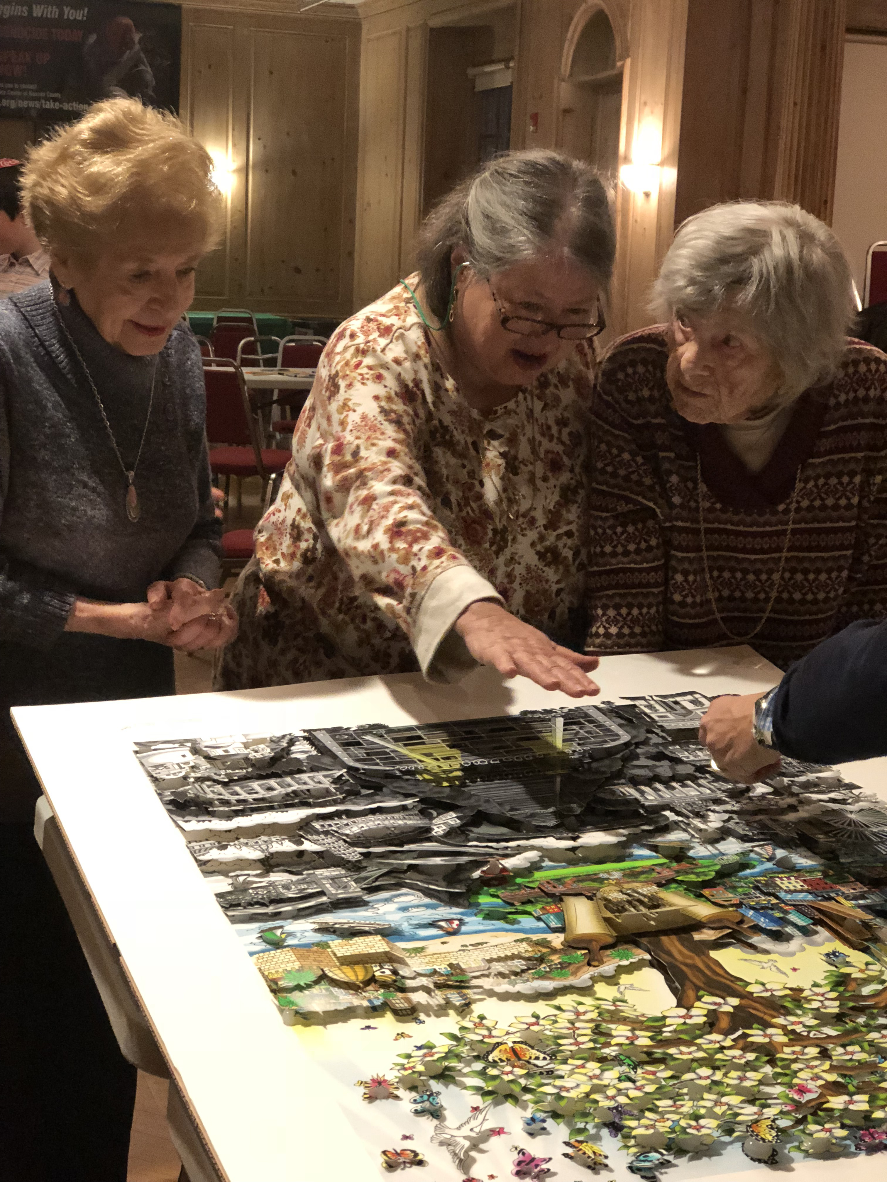 """Anita Weisbord, Ethel and Felice Katz work on recreating """"After the Darkness"""" 3d pop art piece by Charles Fazzino"""