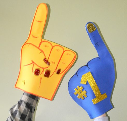 Orange and blue foam fingers cheering for their favorite team