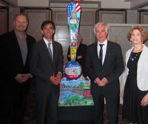 Image of Charles Fazzino, New Rochelle Mayor Noam Bramson, La Rochelle France Mayor Bono, Anniversary Gala Chair Marianne Sussman all standing next to the New Rochelle Fazzino Installation