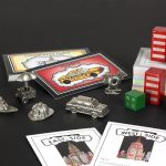 Close up of all the Fazzino Monopoly pieces and cards