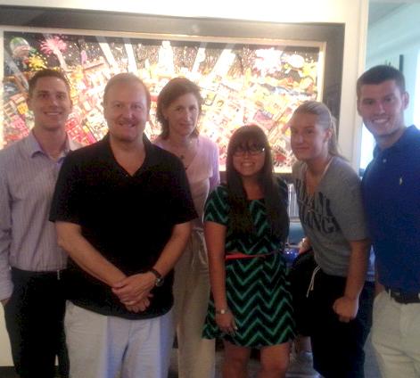 Charles Fazzino posing with the Iona College Team Fazzino members: Brandon Crane, Reed Kochanek, and Cassie Moniodes.