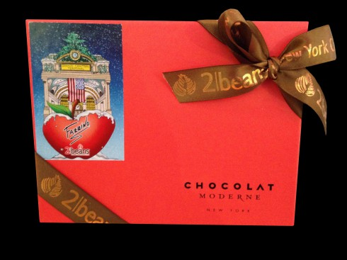 Image of the top of the 2 Beans, Fazzino style box of chocolate, with a red cover and an image of Fazzino pop art