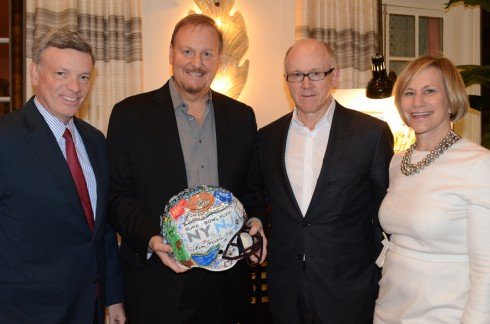 Fazzino posing for a picture with Al Kelly, Woody Johnson, and Laura Tisch at the Super Bowl artwork reveal at the Holiday House in NYC