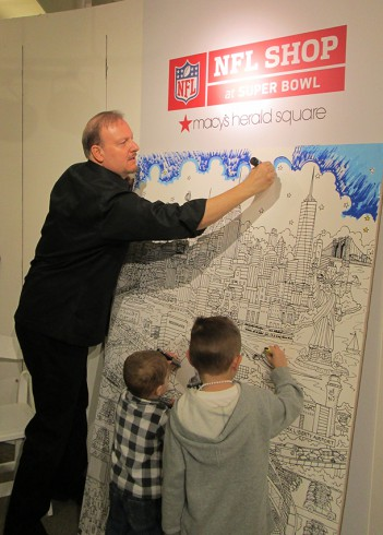 Working with Young Artists at Family Day to color in a giant version of the Super Bowl Artwork