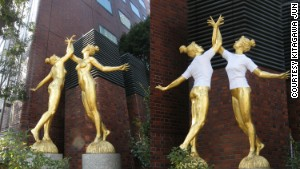 Image of elegant gold female statues tagged with Jun Kitagawa's white t-shirts