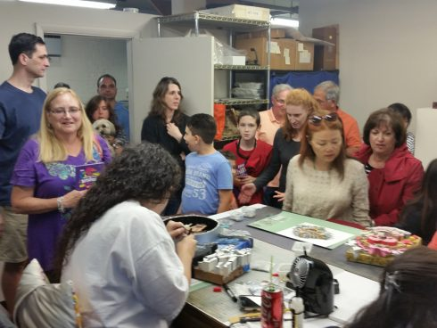A group of fans inside the Fazzino art studios getting a behind the scenes glimpse of work in progress