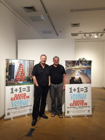 Charles Fazzino and David Gerstein pose in front of posters for their joint exhibition in New Delhi