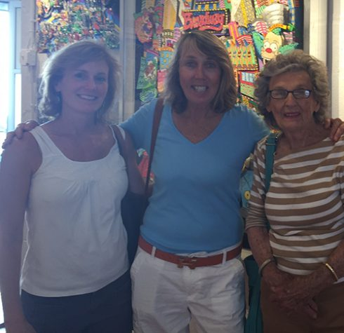 Three teachers from New Rochelle pose for a photo in front of a Fazzino Broadway piece