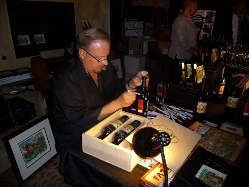 Charles Fazzino signing bottles at the Winery at St. George Napa Valley Blend Release Party