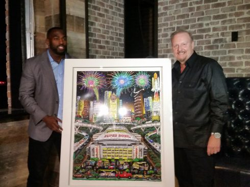 Houston Texan Whitney Mercilus with Charles Fazzino standing with the Super Bowl LI poster