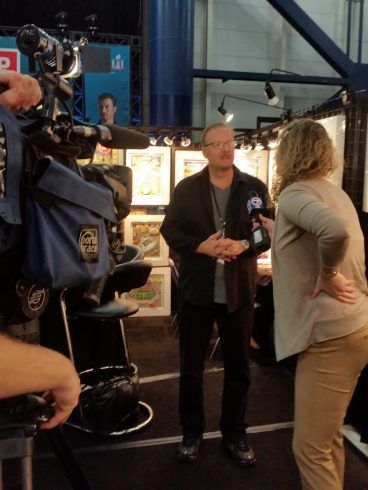 Charles Fazzino being interviewed at the NFL experience for Super Bowl 51