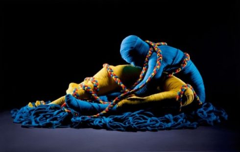Eric Ravelo, yarn artist, two blue and yellow bodies