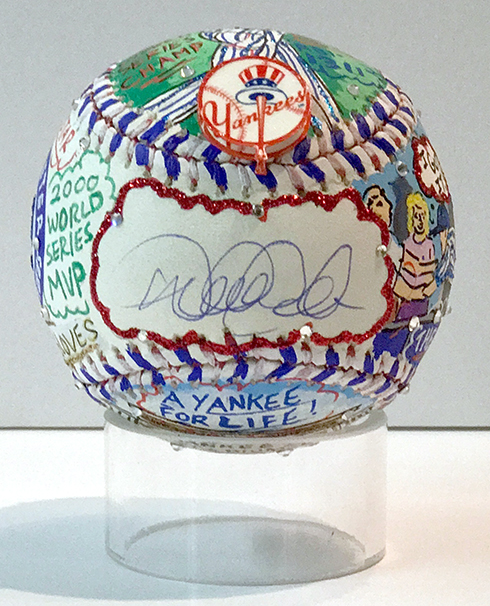 One side of the baseball has a place for a signature, in this case Derek Jeter