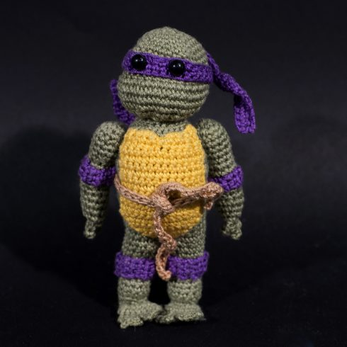 Purple and grey crocheted ninja turtle with a yellow shell and a purple mask | Christina's Crocheted Characters