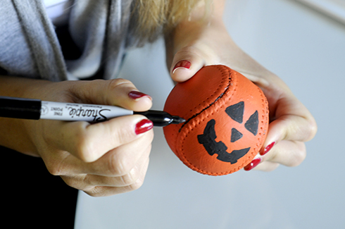 Using an art marker to highlight the stitching on a baseball