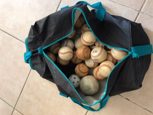 Black bag full of old baseballs - Kids Need More Art and Charles Fazzino All Star Ball Star contest