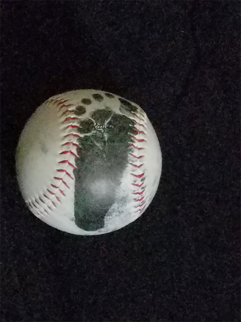 A baseball with a footprint of a newborn baby