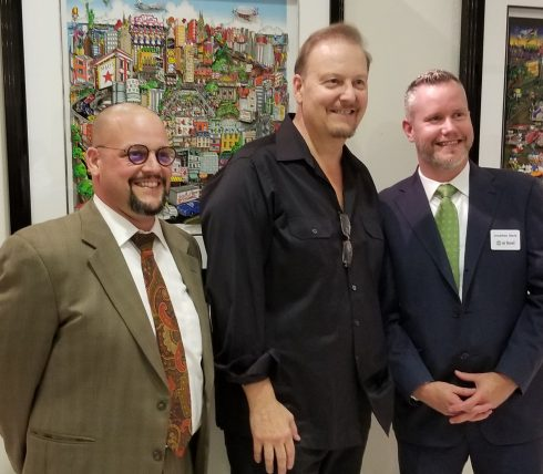 "Charles Fazzino pictured in front of his 3D works at the opening of ""The 3D World of Fazzino"" at the MAC Gallery in New Rochelle"