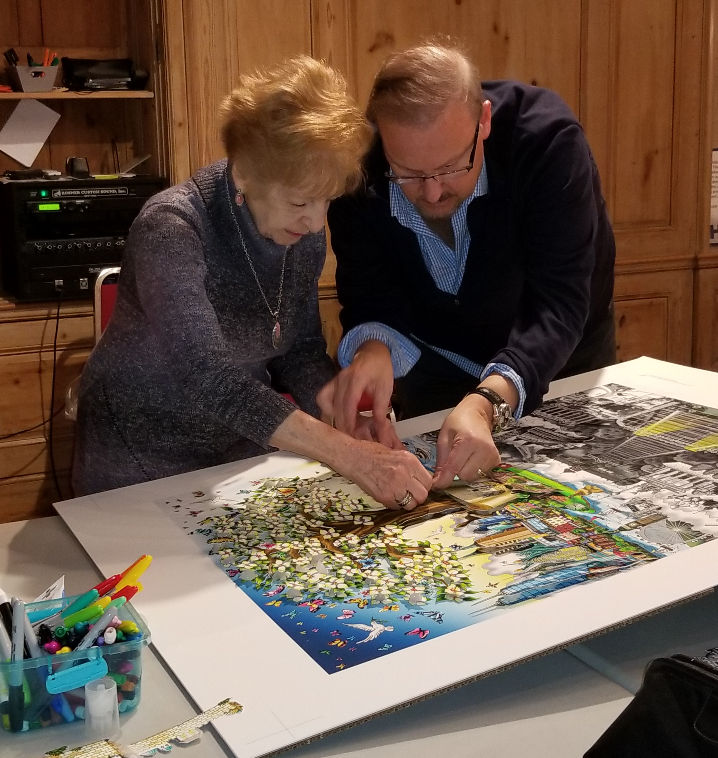 "Charles Fazzino and Holocaust survivor work on recreating 3d pop art piece ""After the Darkness."""