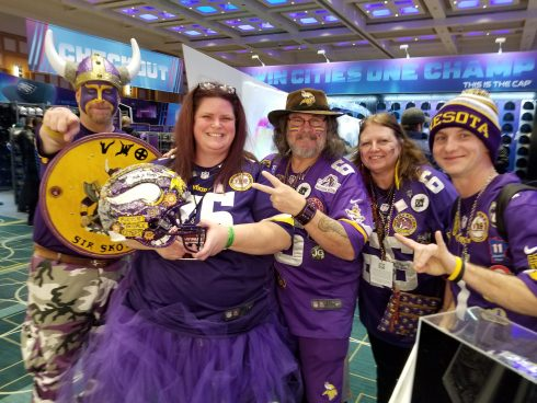 Family of five dressed head to toe in vikings gear at the Super Bowl Experience in Minneapolis