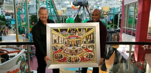Charles Fazzino presented Entertainment Tonight Host Kevin Frazier with an original painting commemorating the shows long history. The segment was filmed during Super Bowl week at the NFL Super Bowl Media Center at the Mall of America
