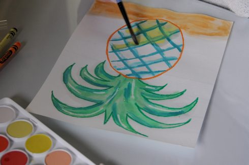 Working additional layers over on the pineapple painting with watercolors