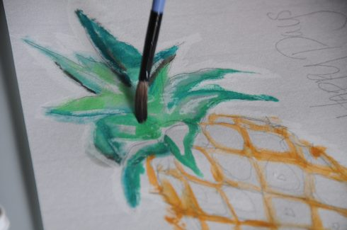 Coloring the leaves of a pineapple with wet on wet watercolor techniques