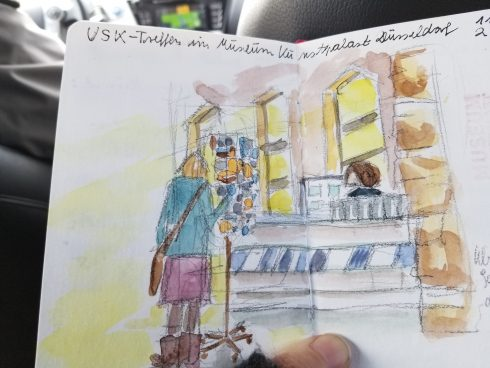 A German taxi drivers colored sketch of a person looking through a rack at a gift shop - Urban Sketchers society