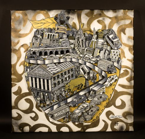 A black and grey city skyline inside of a golden apple - Golden Apple Collaboration  done by Charles and Heather Fazzino