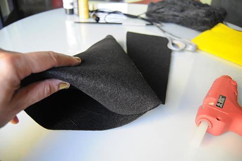 Cutting the excess felt and tucking in the front flap