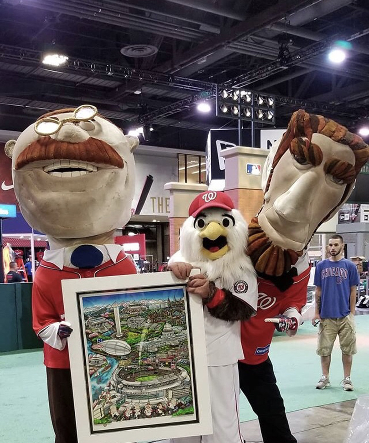 Team mascots holding up Fazzino's MLB 2018 All Star Baseball poster at Fan Fest