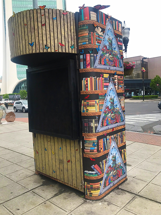 Kiosk in front of Ferguson Library in Stamford Connecticut wrapped in artwork from Charles Fazzino