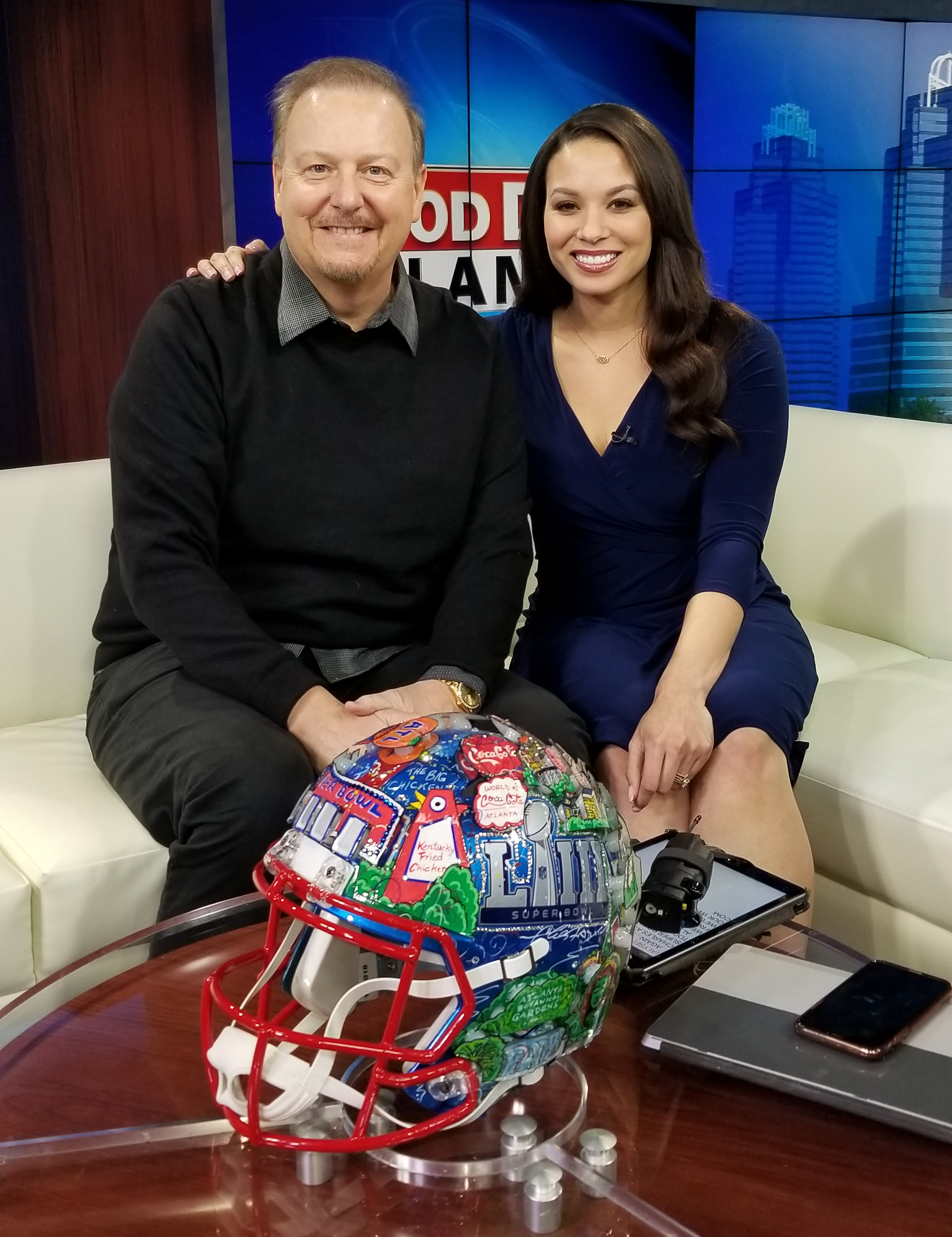 Charles Fazzino on Fox 5 Good Day Atlanta posing in front of his helmet artwork for Super Bowl LIII