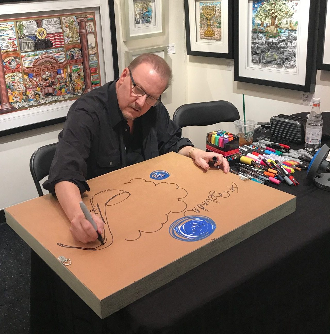 Fazzino sits down at the Wentworth Gallery to start a live drawing for fans to watch
