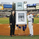 Charles Fazzino presents a retirement gift to NY Yankee legend Derek Jeter on the field at Yankee Stadium