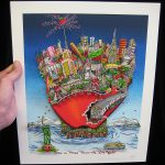 hand holding an pop art print of the new york city skyline in the shape of a red apple and a nyc subway train going through it like a worm, floating on an island next to the statue of liberty- 3D Pop Artist Charles Fazzino